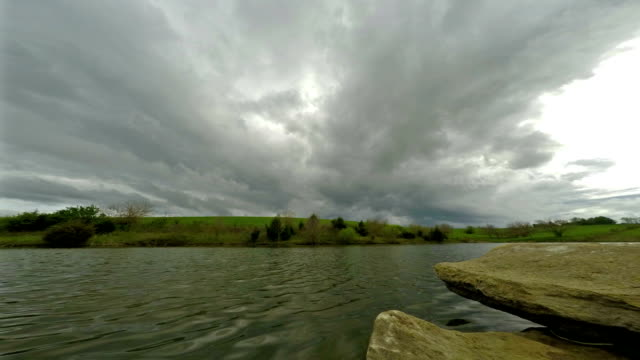 Clouds and rain over lake video