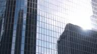 Clouds and Sun Reflect Off Skyscraper video