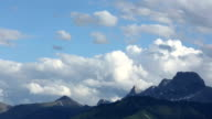 Clouds billow above mountains video
