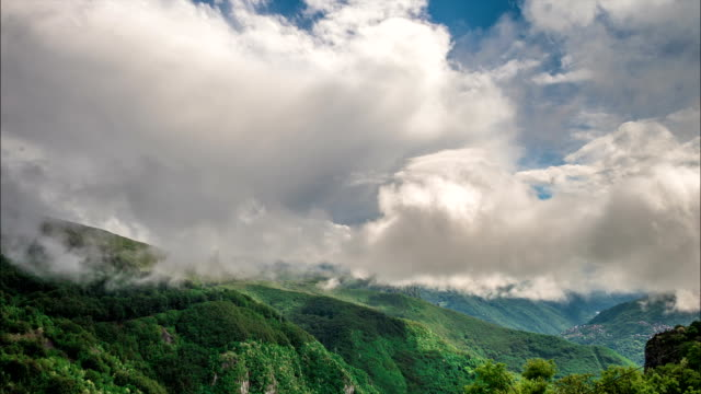 Clouds billow over mountains video