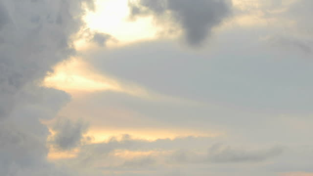 clouds forming above sunset video