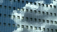 Clouds in reflection on the office building video