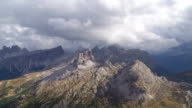 Clouds Moving Over Dolomites Mountains TILT UP video
