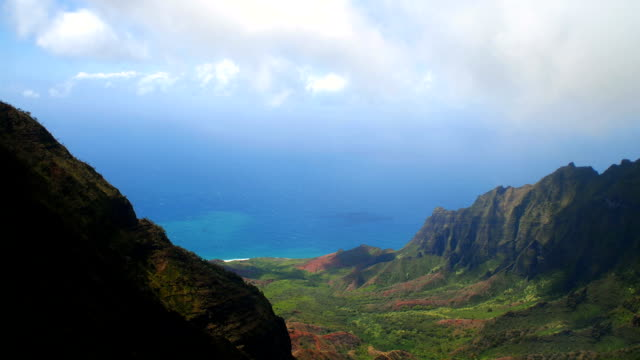 clouds moving over lush valley overlooking na pali coast video
