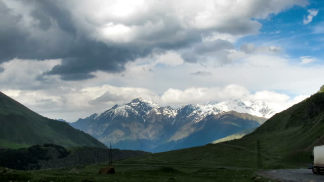 Clouds Moving over the Georgian Mountains. Mount Kazbek. Time Lapse video