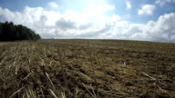 Clouds over arable fields, time lapse video