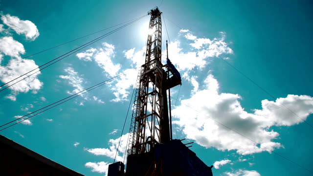clouds over drilling rig video