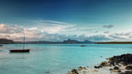 Clouds over paradise rocky tropical island timelapse video