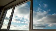 Clouds seen through large, domestic windows. video