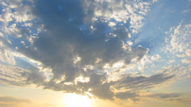 clouds with sun rays time lapse video