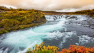 T/L Cloudscape over beautiful Bruarfoss waterfall video