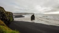 T/L Cloudscape over black rock in the sea video