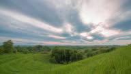 8K T/L Cloudscape over green terraced hills video