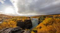 T/L Cloudscape over Hraunfossar waterfall video