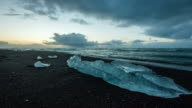 T/L Cloudscape over Icebergs on the black beach video