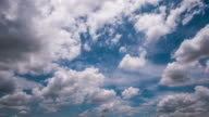 Cloudy movement time-lapse on blue sky , nature background video