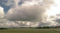 Cloudy sky behind train window. video
