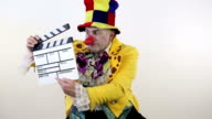 Clown with a movie clapperboard video