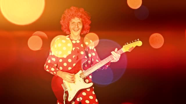Clown with guitar awesome bokeh video