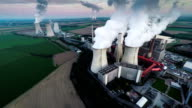 AERIAL: Coal fired power station at dusk video