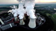 AERIAL: Coal fired power station with cooling towers releasing steam into atmosphere video