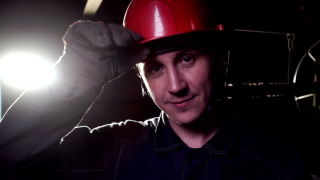 Coal miner, portrait of a young miner or stoker in the workplace video