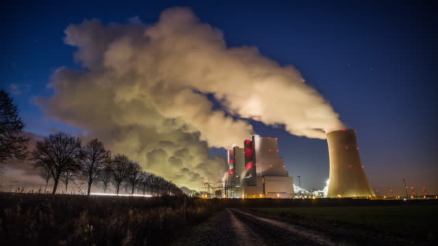 Coal Power Plant at Night - Tracking Shot Time Lapse video