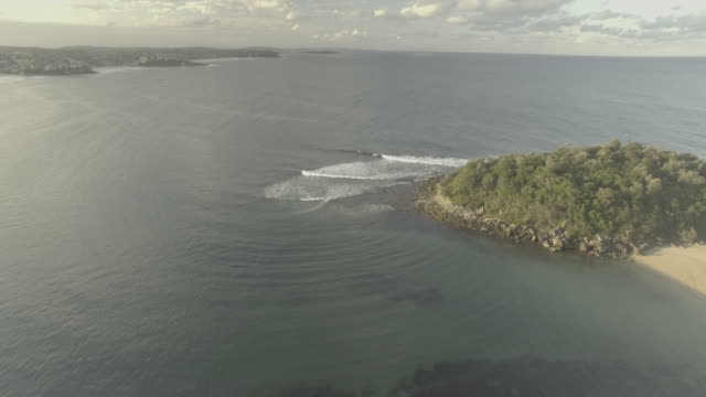 Coastal beach, wave and rock aerials video