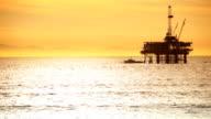Coastal Oil Drilling Sunset video
