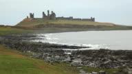 Coastline and Ruin of Dunstanburgh Castle video