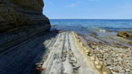 Coastline area near old city Piran and Strunjan, nice place for swimming with St. George's Parish Church view. Summer day, clear water in the sea and blue sky. Slovenian Istria, Slovenia. video