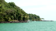 Coastline seen from the ship. Tropical rainforest and turquoise water video
