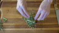coating fine chopped herb on butter video