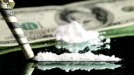 Cocaine Snorted through Rolled 100 Dollar Banknote video