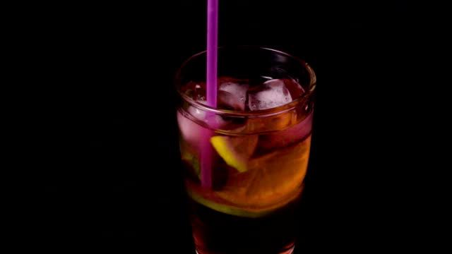 Cocktail stir drinking straw super slow mo video