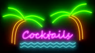 Cocktails neon sign lights logo text glowing multicolor cocktail video
