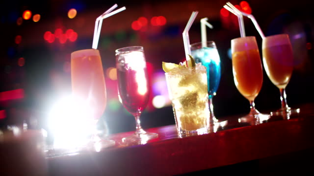 Cocktails on bar counter in night club video