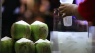 Coconut and Fruits juice pouring into glass video