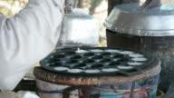 Coconut milk mix with powder fried dessert. video