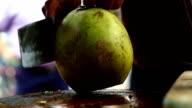Coconut opening breaking by machete video