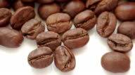 coffe beans flow over white background fill frame video