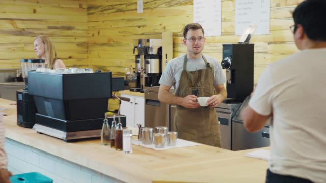 Coffee Bar Owner Serves Patrons video
