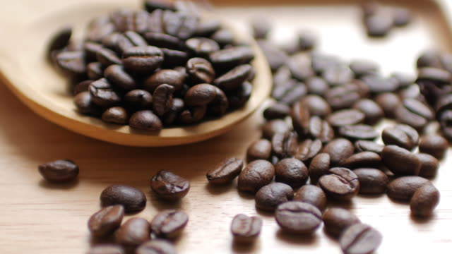 Coffee Beans and Hot Black coffee on Wooden dish on white table background , dolly shot Defocus video