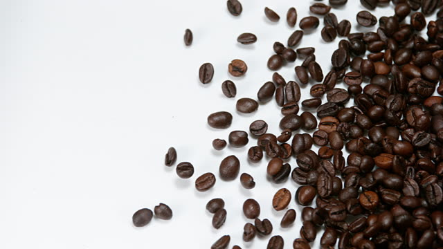 Coffee Beans Falling against White Background, Slow Motion 4K video