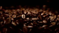 Coffee beans falling commercial in super slow motion video