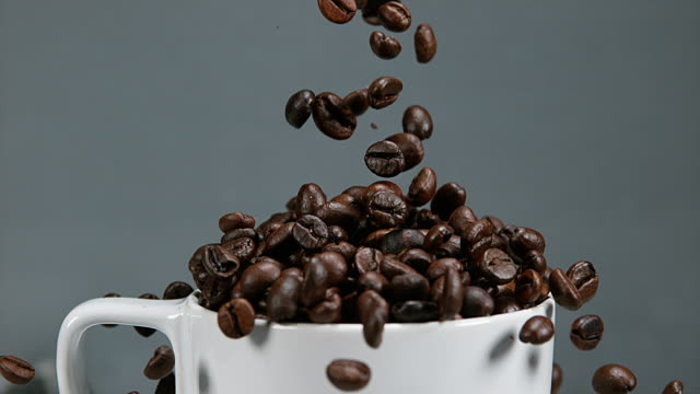 Coffee Beans Falling into a Cup, Slow Motion 4K video