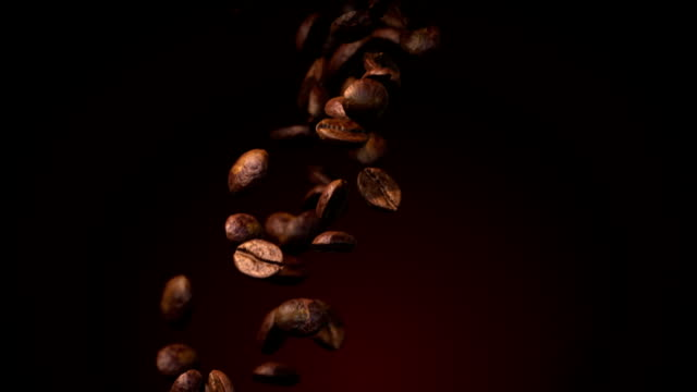 Coffee beans flow in slow motion video