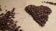 Coffee beans heart shape dolly move video