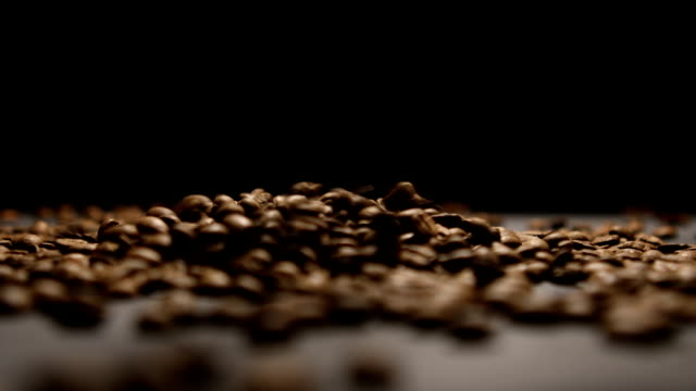 Coffee Beans on black table video