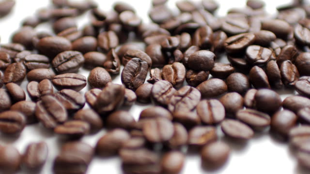 Coffee Beans on white table background , dolly shot left to right video